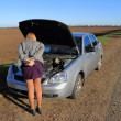 Stock Photo: Girl's car broke down