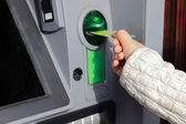 Person uses an ATM — Stock Photo