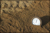 Clock in the sand — Stock Photo