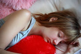 Teen girl on the bed — Stock Photo