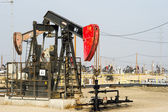 Pumping oil in Kern County, California — Stock Photo