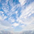 Blue sky background with tiny clouds — Stockfoto