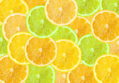 Abstract three-color background with citrus fruit of grapefruit, — Stock Photo
