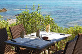 Setting table fron of the sea — Stock Photo