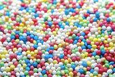 Primer plano de brighly color pastel sprinkles. — Foto de Stock