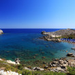 Azure waters at a small Bay in Rhodes Greece — Stock Photo