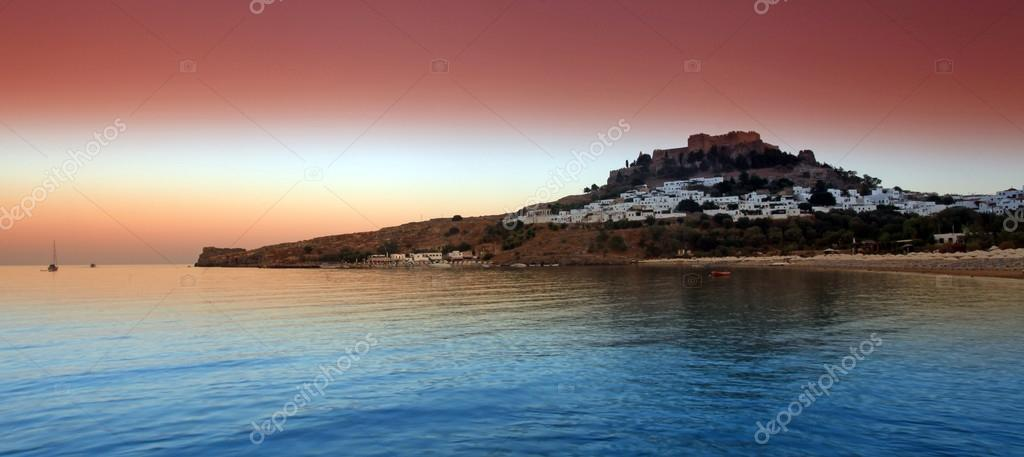 Lindos sunset in Rhodes Island — Stock Photo #13493475