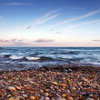 Budliegh Beach at sunset — Stock Photo