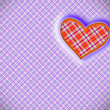 Heart on a lilac pattern of a cage — Stock Photo