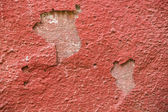 Detail of a red plaster partially peeling off — Stock Photo