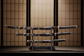 Katana, wakizashi and tanto on stand in a room — Stock Photo