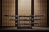 Katana, wakizashi and tanto on stand in a room — Stock Photo