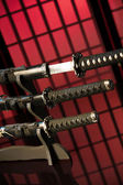 Drawn katana with other swords on red background — Stock Photo