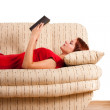 Lying woman in red shirt reading book. Detail — Stock Photo
