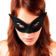 Red-headed woman in the mask — Stock Photo