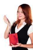 Woman viewing her gift - necklace. Zoomed in. — Stock Photo