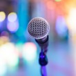 Detail of microphone with blurred party lights — Stock Photo #38866763