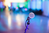 Microphone with blurred party stage around — Stock Photo