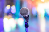 Detail of microphone with blurred party lights — Stock Photo