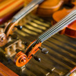 Violin detail with another one and cimbalom behind — Stock Photo #43385131