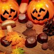 Autumn still life with halloween pumpkin, mushrooms and chestnuts — Stock Photo