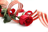 Romantic red rose and ribbon — Stock Photo