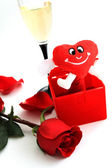 Red rose, glass of wine and red heart — Stock Photo