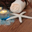 Royalty-Free Stock Photo: Spa concept with blue candles, bath salt and starfish