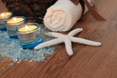 Spa concept with blue candles, bath salt and starfish — Stock Photo