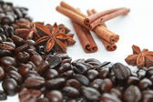 Coffee beans, star anise and cinnamon sticks isolated on white — Stock Photo