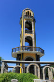 Bell tower, near the statue of the Virgin Mary — Stock Photo
