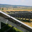 Green energy solar panels for valley village — Stock Photo