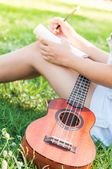 Song writer with little guitar — Stock Photo