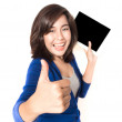 Isolated portrait of beautiful young woman thumb up with digital — Stock Photo #46683145