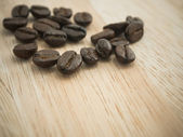Coffee beans on wood — Stock Photo