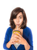 Beautiful young  woman drinking in yellow paper cup with straw o — Stock Photo