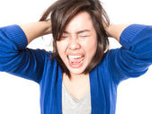 Young stress woman going crazy pulling her hair in frustration o — Stock Photo