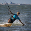 Kitesurfing on wave board in Haikou — Stock Photo