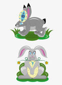 Easter rabbits and eggs. — Stock Vector
