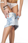 A young sexy adult girl take off shorts — Stock Photo