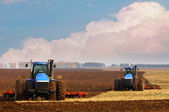 Tractor in the field. Tractor at the seed — Stock Photo