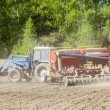 agricultural work plowing land on a powerful tractor — Stock Photo