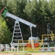 Oil pump jack in operation — Stock Photo