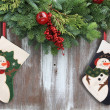 Christmas garland and stockings. - Stock Photo