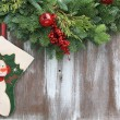 Christmas stocking and garland - Stock Photo