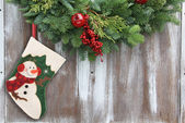 Christmas stocking and garland — Stock Photo