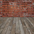 Stock Photo: Wooden floor and brick wall.