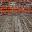 Wooden floor and brick wall. - Stock Photo