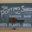 Old potting shed sign — Stock Photo