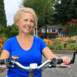 Senior lady cyclist — Stock Photo